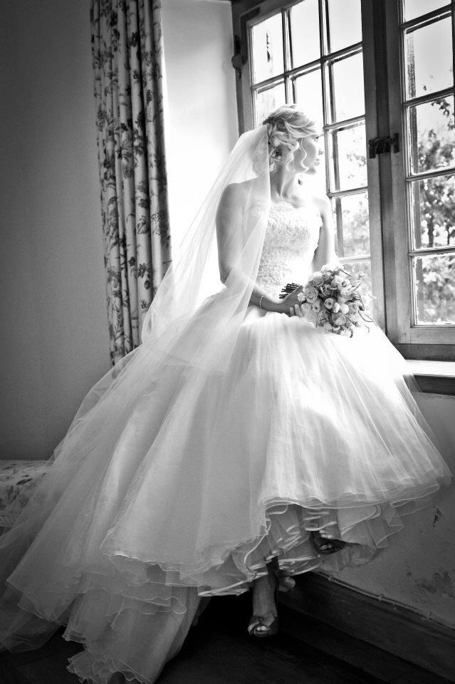 Adele wearing a custom wedding dress from the Ethereal Collection.