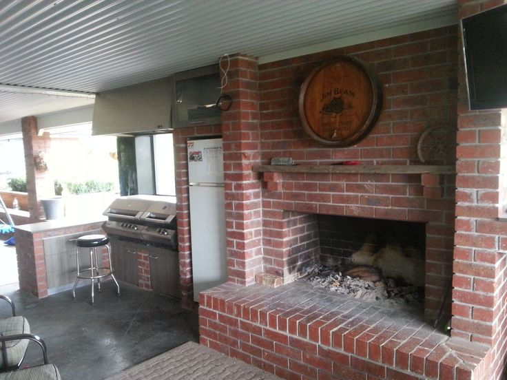 indoor / outdoor living area set up with fireplace and BBQ