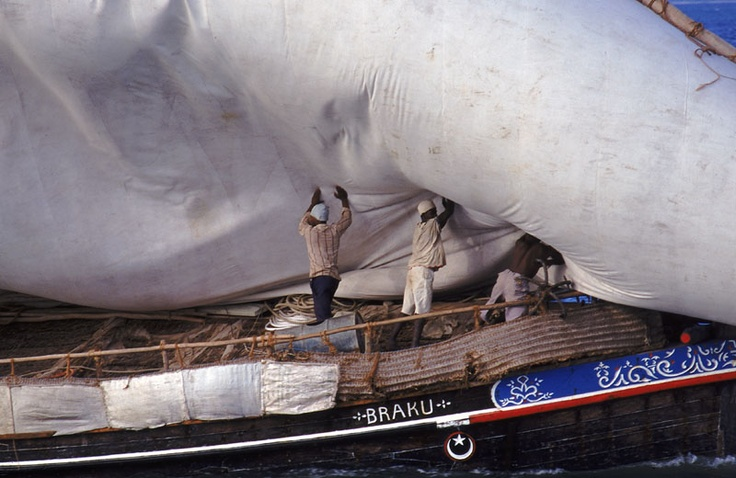 Dhow lowering sail