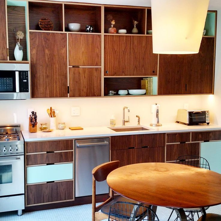 Walnut plywood kitchen with open cubbies by Kerf Design. Follow @kerfdesign on instagram to see more of our work!