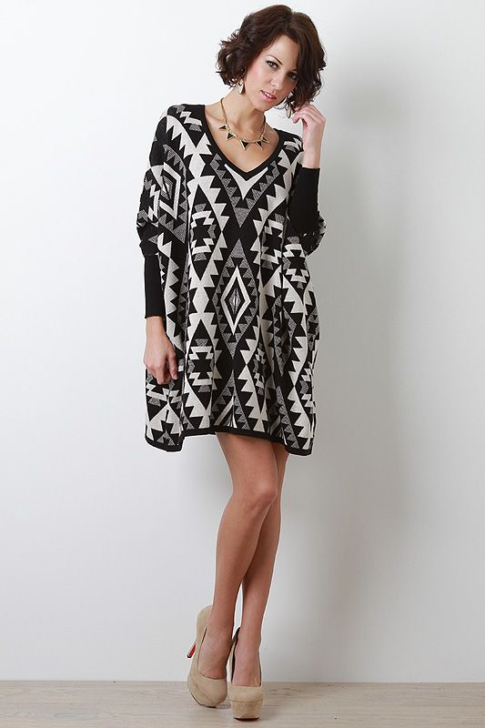 Connect with your free spirited side with this Indian Trails Sweater Tunic. This comfy knit tunic can be worn as you please, with its contrasting tribal print patterns, long dolman sleeves, and v-neckline.