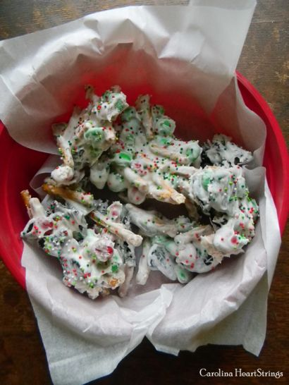 REINDEER CHOW:  16 whole Oreo Cookies, Broken Into Pieces,  2 cups Pretzel Sticks (broken),  2 cups Holiday Colored M & M's,  16 ounces Vanilla Candy Coating (or White Almond Bark),  ¼ cups Holiday Sprinkles.