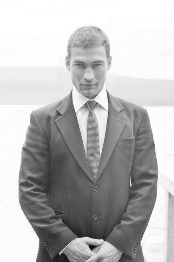 Young Patrick Stewart in Black Suit