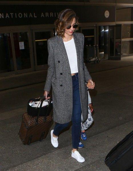 Miranda Kerr Photos - Model Miranda Kerr is seen arriving on a flight at LAX airport in Los Angeles, California with her boyfriend Evan Spiegel and her son Flynn on July 3, 2016.
