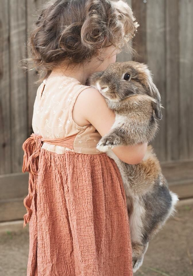 a girl and her bunny. This would have been little me
