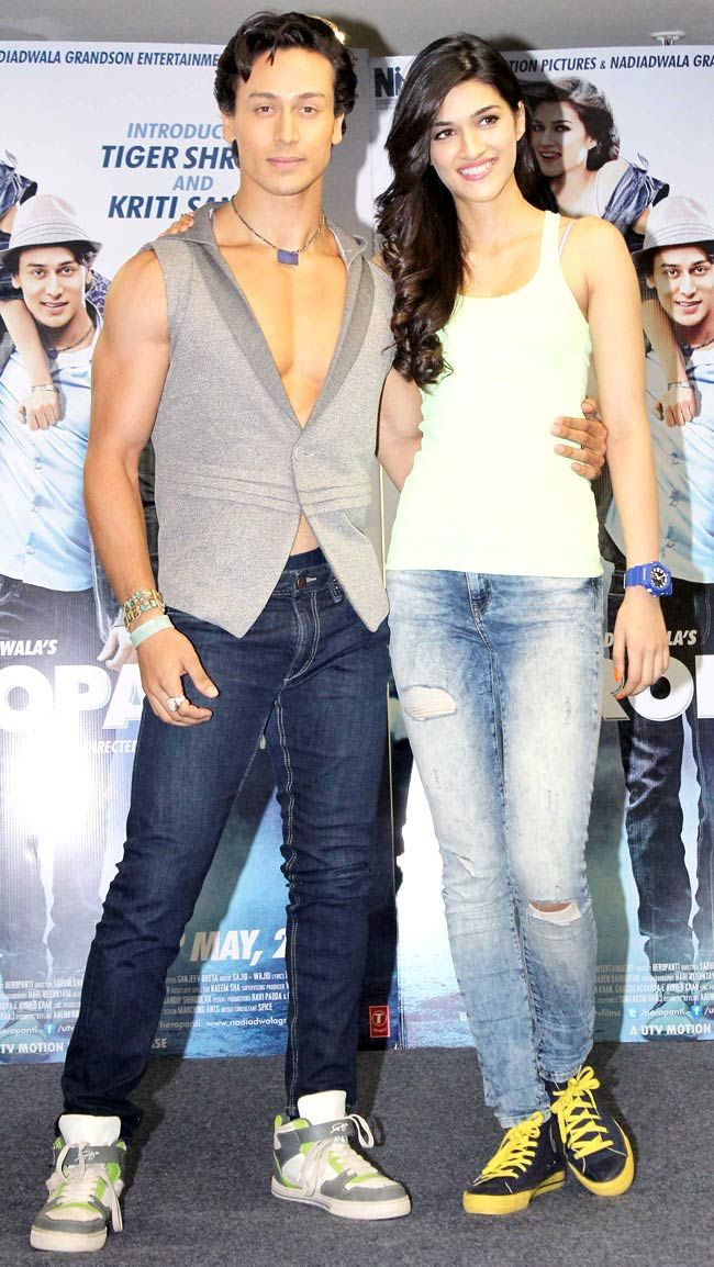 Tiger Shroff poses with Kriti Sanon while celebrating 'World Dance Day'. #Style #Bollywood #Fashion #Beauty #Handsome