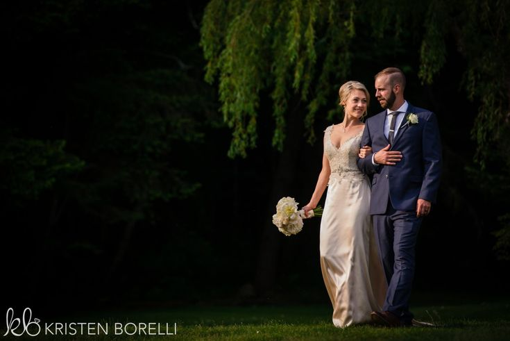 Thetis Island Overbury Resort Wedding. Bride and groom portrait. Groom wearing navy blue tux, bride wearing lace and satin gown.