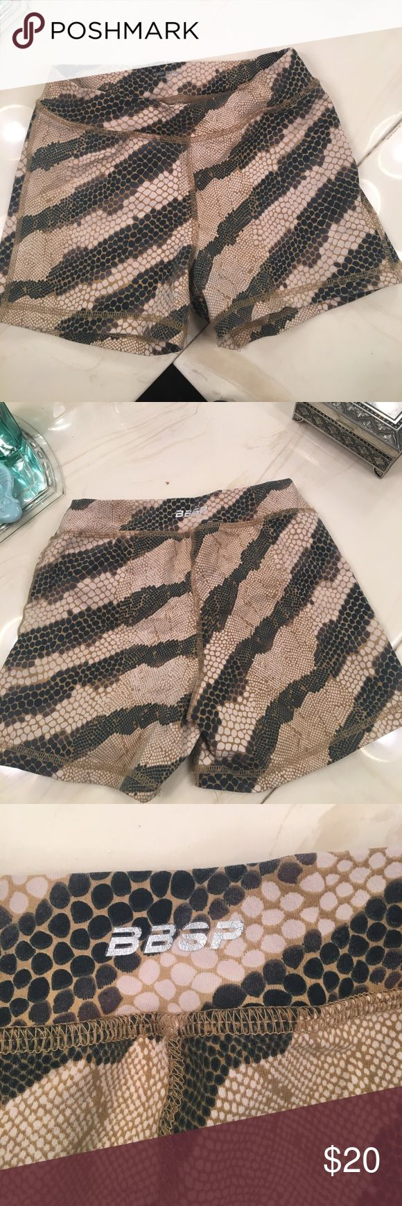"""Bebe sport snake skin booty shorts Bebe workout shorts great for running, crossfit....  just slightly faded. Price is reduced for it. Still in great condition. 2.5"""" inseam bebe Shorts"""