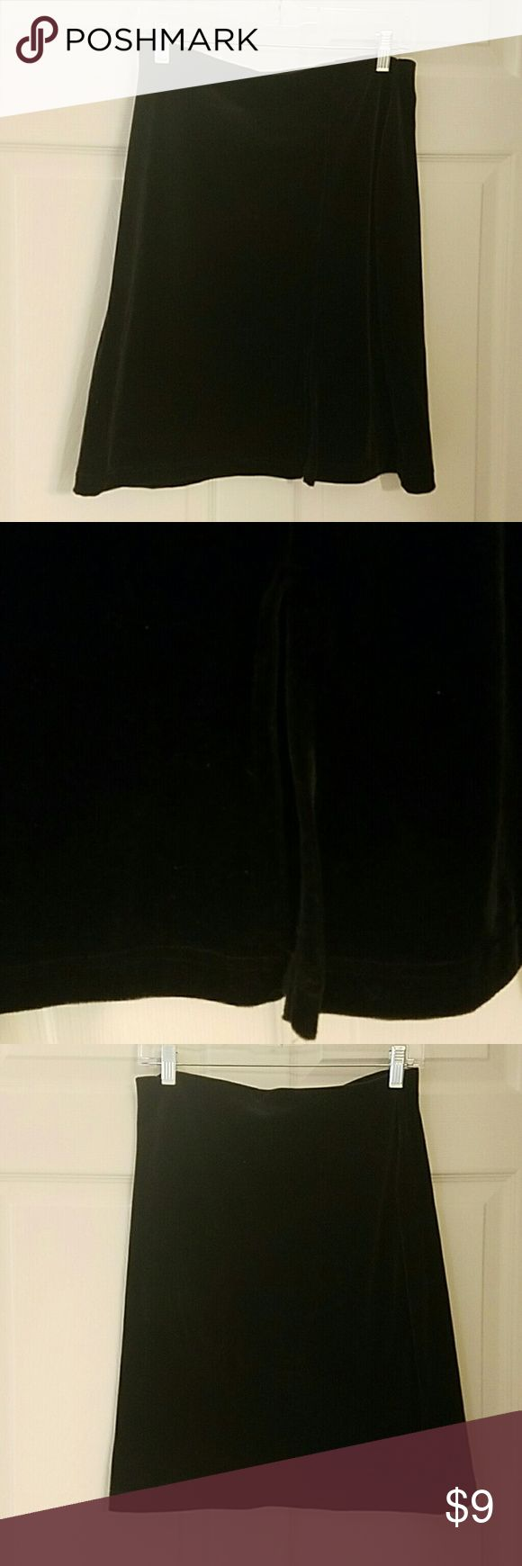 """Womens size L Black velour skirt Black velour skirt. Length is approximately 22"""". Small slit in the front. Slit is 7"""". Elastic waist. Really smooth and comfy. one step up Skirts"""