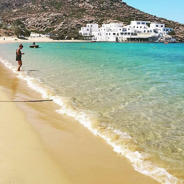 Exotic beach of Mylopotas at Ios island ( Ίος ) . Golden sand & magical crystal-clear sea , perfect combination to enjoy your sunbathing ☀️