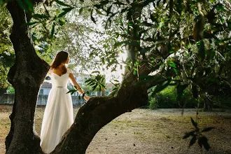 The amazing bride is posing between the olive trees - white and green - perfect combination - http://www.kefaloniawedding.com/ #weddingingreece #kefalonia #mythosweddings
