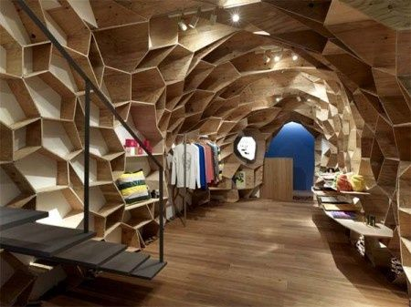 Lucien Pellat has opened a shop in Tokyo designed by Kengo Kuma. Kengo Kuma created a honey-comb wood structure that engulfs the store ingeniously creating a dramatic design effect while also giving a new take on traditional boring retail shelfs.