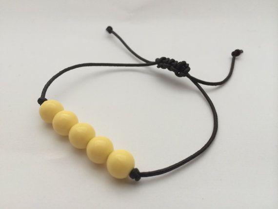 Leather and buttercup yellow beaded bracelet by BillyandElizabeth, $5.00