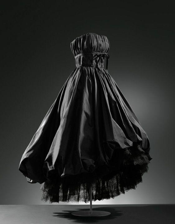 House of Balenciaga. Founded 1937. Designer Christobal Balenciaga. Spanish Basque 1895-1972. Evening dress in black satin, 1952