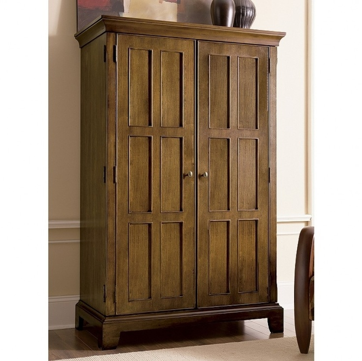 built in master power control panel the riverside urban crossings computer armoire in canyon oak has a pullout task light and open storage