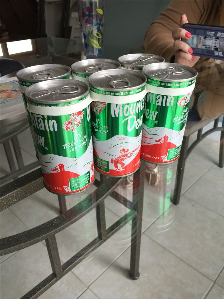 """Ya hoo. Mountain Dew. Original design. This six-pack of vintage original Mountain Dew cans came from pre-production """"product testing"""" that I got from a beverage distributor in 1968.  The hillbilly is gone now. Crack-a-Dew."""