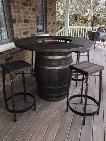 Love this wine barrel table & chairs