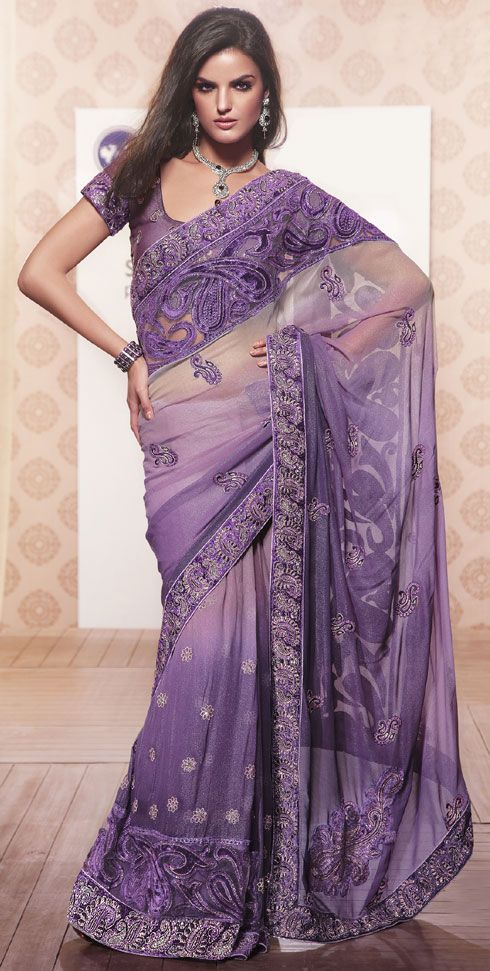 A beautiful shimmer saree is in purple and lavender shaded combination.