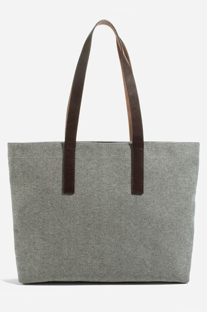 Everlane tote- You can put your faith in this all-twill tote. Leather straps will hold the weight of your laptop, while the cotton interior and exterior keep your belongings protected from any bump-ins on the street. And, a top zipper adds another layer of security (and piece of mind) for the urban-dweller.