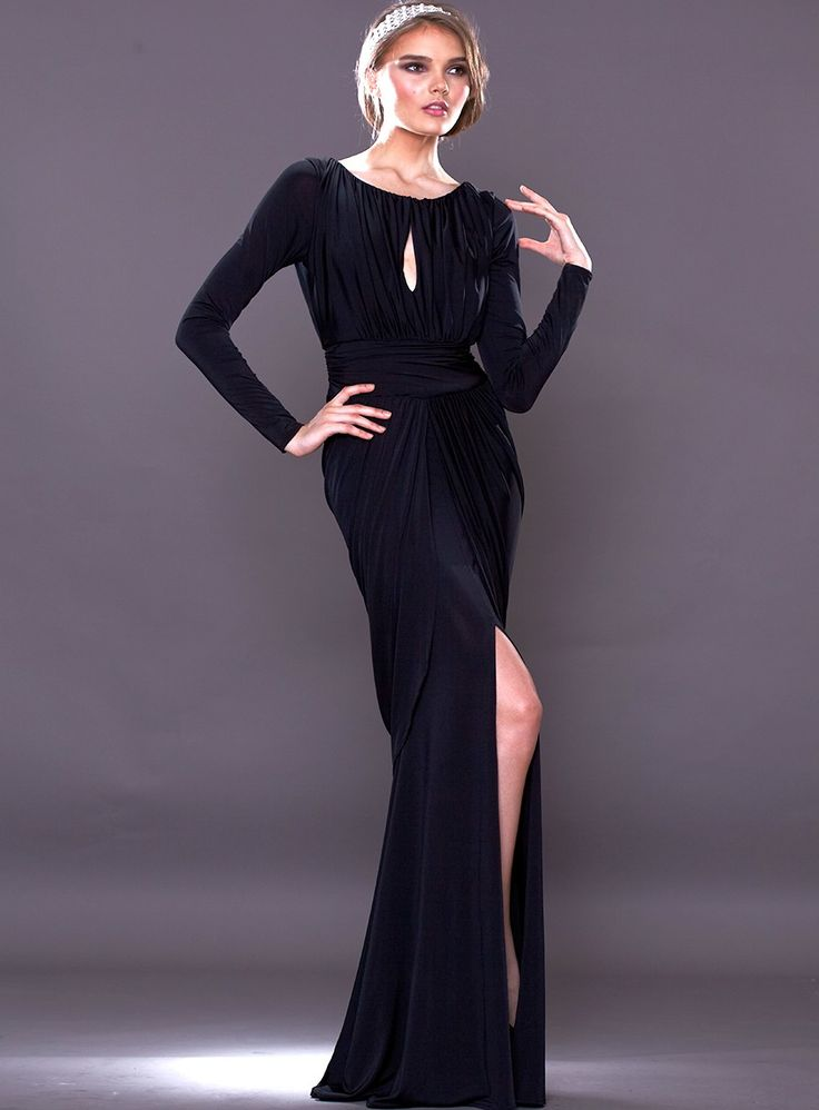 The Laurena Dress by Pia Gladys Perey is a flattering full length gown with a keyhole neckline and long sleeves. Features a sexy leg split a...