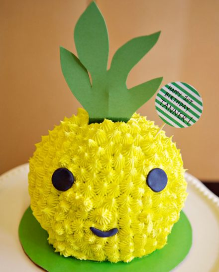 Pineapple Head Cake:  What's that you say? You've never seen a pineapple head cake before? This giant pineapple head cake was the centerpiece at a Hawaiian themed 1st birthday party! The sphere was made using a ball shaped cake pan and piped using an open star tip, creating yellow drop stars all over the cake to give it a spiked feel. Eyes and mouth are fondant, and the stem is made from craft paper which matches the cake board.