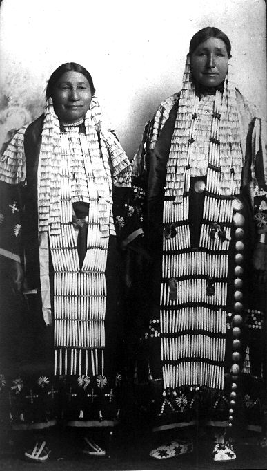 Lakota women wearing porcupine quill and dentalium shell decorations. | ca. prior to 1807