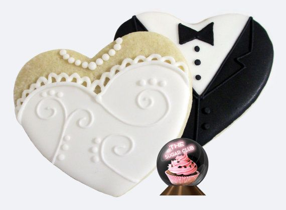 These beautiful bride and groom cookies are the perfect favor to say thank you to your guests for celebrating your special day. Great for weddings, engagements, and even anniversary parties, these gorgeous bride & groom cookies add a classy and tasty touch to your event!  You will receive 1 dozen (12) beautifully detailed, hand-decorated sugar cookies from TheSugarClub are made with real sweet cream butter, pure vanilla, and a delicious almond-vanilla icing:  6x bride heart cookies 6x groom…