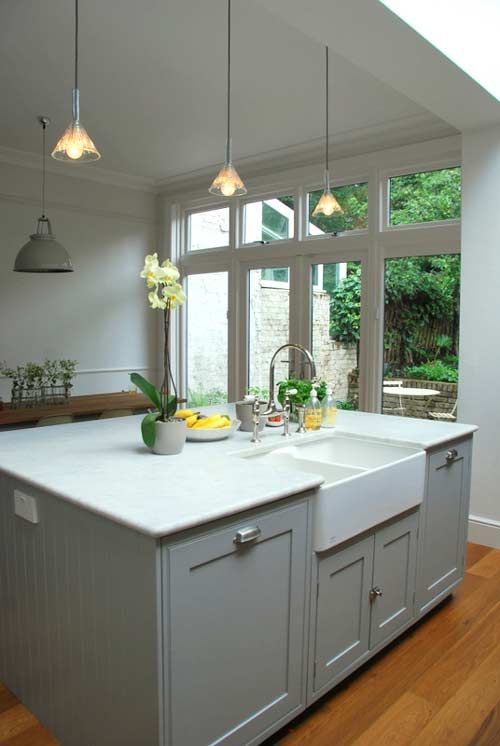 Grey cupboards, marble benchtop, belfast sink, curvy tap, glass doors with highlights... want want need!