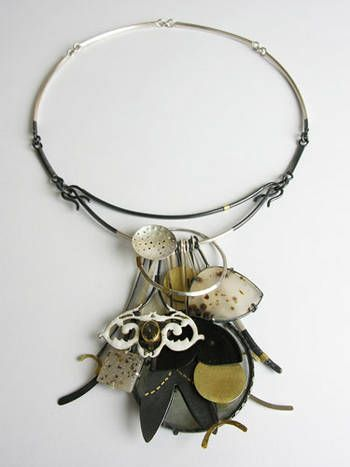 Zoe Arnold  Memory Necklace, with clustered pendants and hoarded possessions, is modern take on the charm. More sculptural pieces can be displayed on the wall when not being worn.