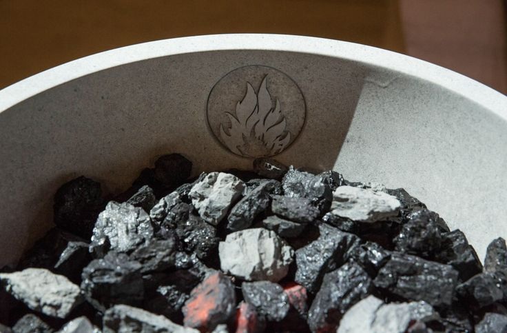 At the Dauntless choosing ceremony, they have lit coals. That is to represent their fiery passion for what they do.