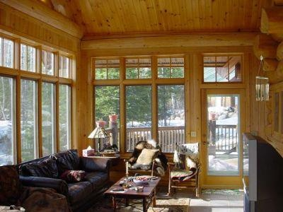 The three season porch cedar logs walls marvin windows for Cedar sunroom