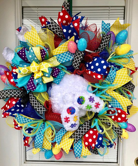 This Happy Easter Bunny Wreath will welcome your guests this Easter season. He is promoting autism awareness. This Autism Bunny is created on a bed of colorful deco mesh. It is centered with the bunny jumping right in the middle of your wreath. There are premium wired ribbon