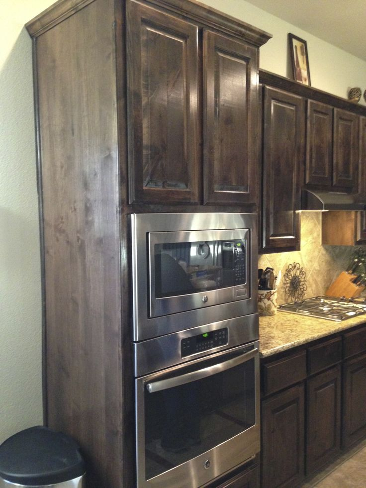 Love the wall oven/microwave and dark stained cabinets