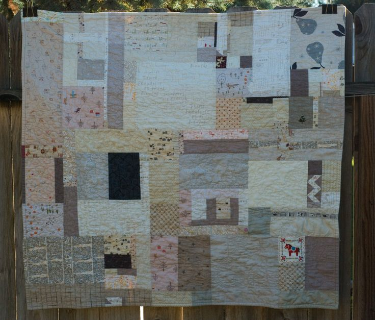 I love this pretty quilt done almost entirely in neutrals.  The tiny bits of color are such nice surprises when you spot them.