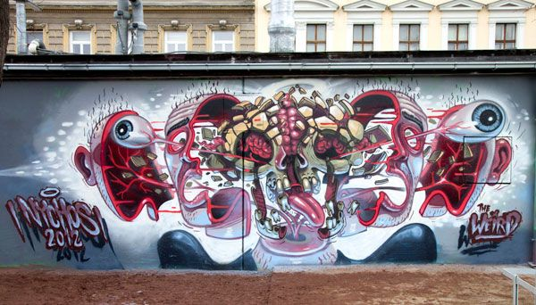 "The streets of Vienna recently received an upgraded with two fantastic new murals by street artist, Nychos. The first wall titled ""Splatterface"" depicts a sectioned head that looks as if it may be exploding.  While the second wall tilted ""A slice of Tuna"" displays a sectioned Tuna with a skeleton inside."