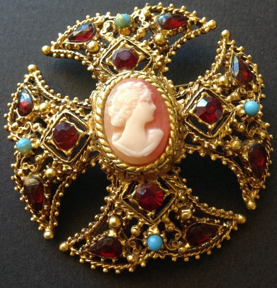 Sensational looking 1960s era signed Florenza Malta cross brooch. Old gold tone filigree cross encrusted with faux turquoise stones & ruby red coloured rhinestones.