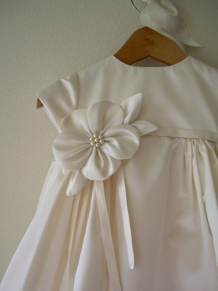 blessing dress - I like the simple, elegant kind. I like the flower on this one.