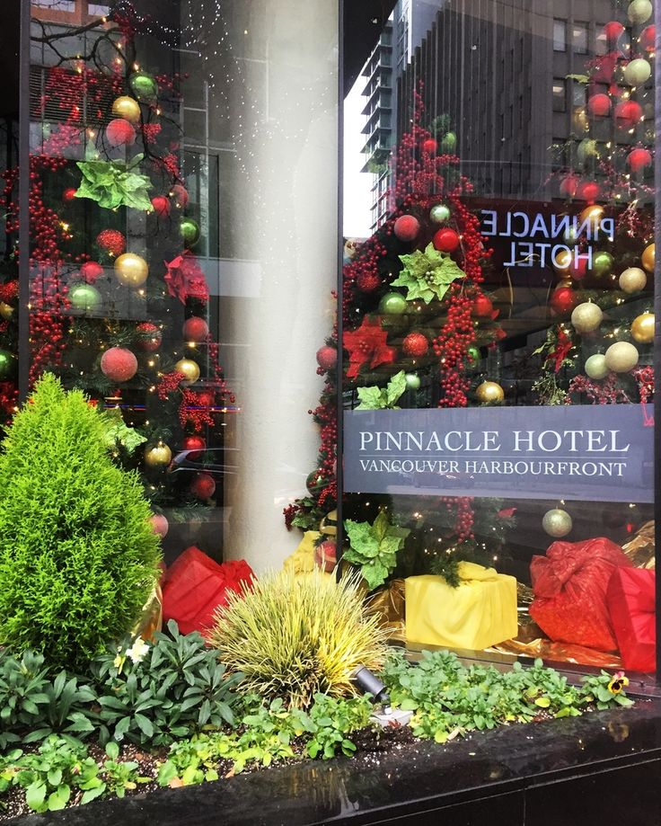 #ISpyTheHolidays in Coal Harbour! Doesn't this window display at the @pinnacleharbourfront make you want to put your tree up too? Who doesn't love walking by beautiful, festive decor. It sure put a smile on our faces!