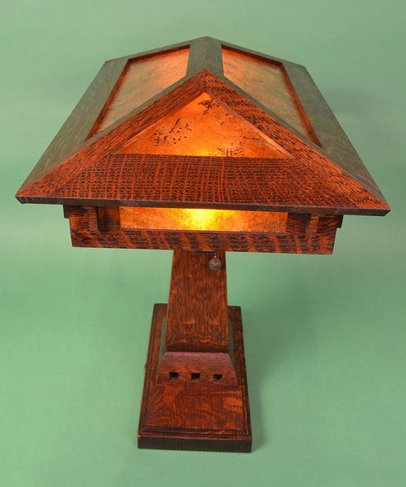 The Prairie Craftsman Desk Lamp is a design originally commissioned for St. Paul Lutheran Church in Green Bay Wisconsin in late 2007. It was designed to fit on a small alter, but also intended to fit on a desk. It stands 17 inches tall, and the shade is 12 inches deep by 18 3/4 inches wide. It is about 14 inches from the bottom of the mica shade to the desk top. Lamp comes with real acorn or solid brass pull chains. The lamp uses highly figured quarter sawn white oak, and the lamp pictured…