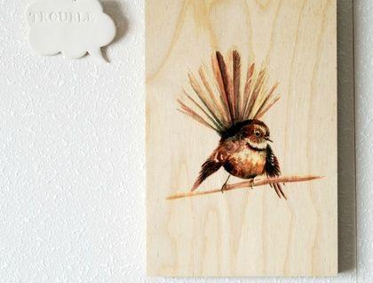 'Piwakawaka' a print on beech wood by ellaquaint 'Trouble' brooch by The Little White Box.