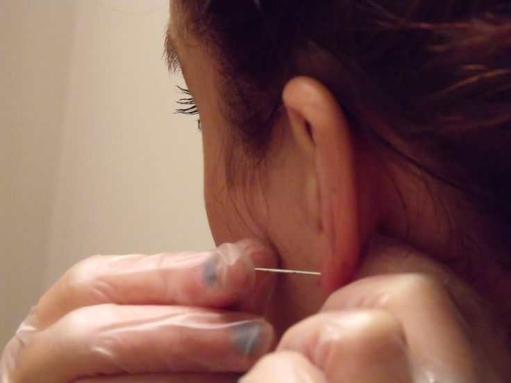 This is how ears were pierced back in the day!....with a needle after freezing your ear with ice.  Yep, that's how mine were done.