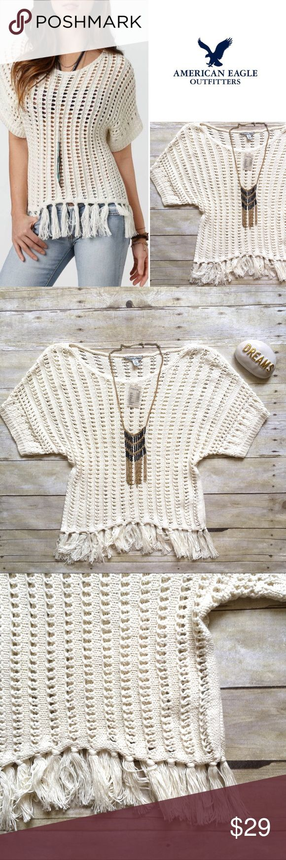 """American Eagle open knit fringe trim sweater Great over a cami. 55% Cotton, 45% Acrylic Soft open stitch cotton blend. Easy, oversized fit. Scoop neck and scoop back. Short dolman sleeves. Ribbed cuffs. New with tags! 24""""L. Size Small. {Location B8} American Eagle Outfitters Sweaters"""