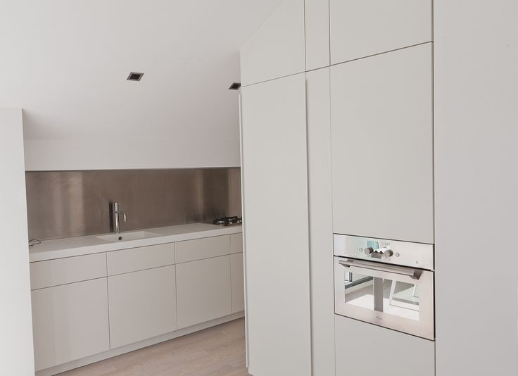 white kitchen in white house, corian countertop