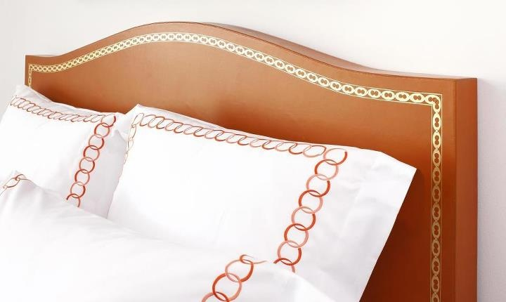 Custom leather headboard with gold hand-tooling. www.larruleathers.com