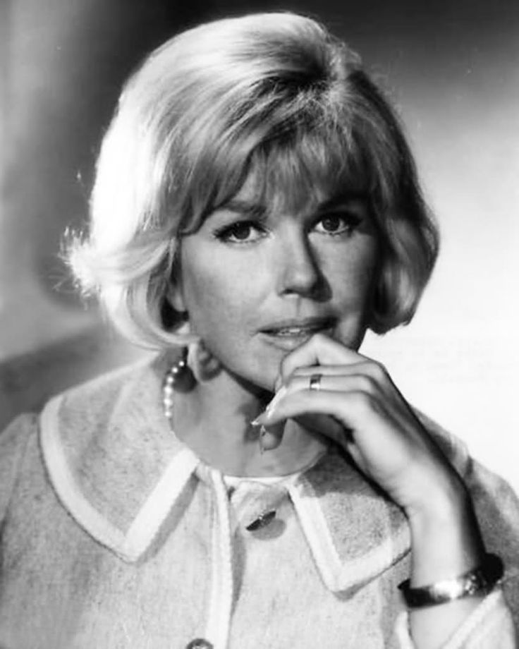 Doris Day Hilarious, classic good looks, wonderful singing voice. She just seems happy go lucky.