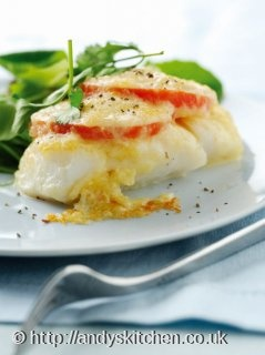 Pan fried cod with cheese and tomato topping
