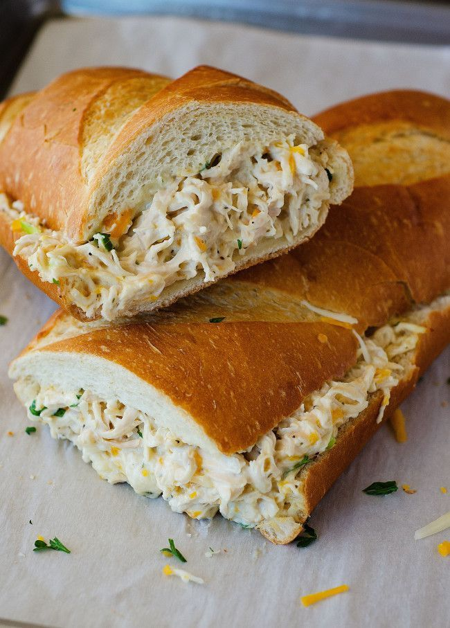 Chicken Stuffed French Bread | 1 loaf french bread 1 pound chicken breasts, cooked and shredded 1 1/2 cups Colby-Jack cheese, shredded 2 green onions, sliced thin 1 to 2 cups Ranch dressing Instructions Preheat oven to 375° F. Line a large baking sheet with parchment or wax paper. Slice the french bread in half lengthwise. Place both halves cut side up on prepared baking sheet. In a large bowl, mix together shredded chicken, cheese, green onions and enough