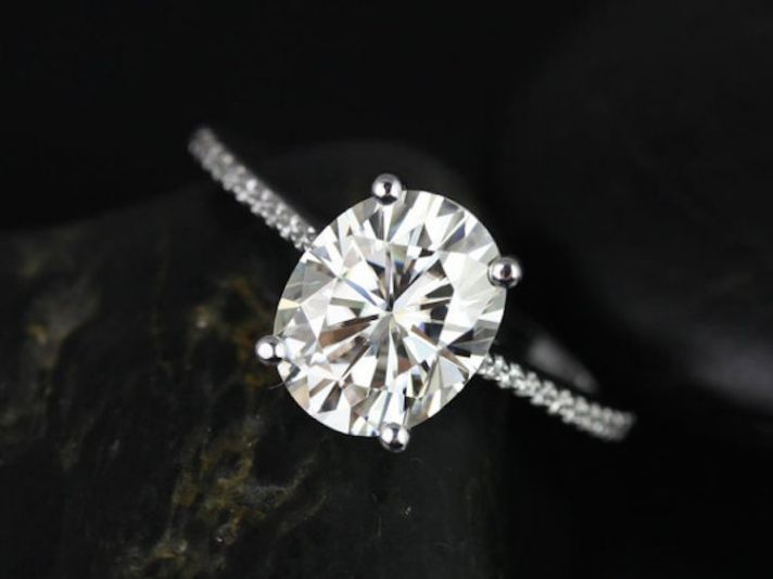 We love how delicate this oval shaped solitaire engagement ring is!