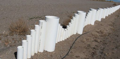 """How to Make a Fence from Recycled Plastic PVC Pipe class= """"I love being a plumbers wife...we always have these pipes just laying around. Time to put them to use!"""""""