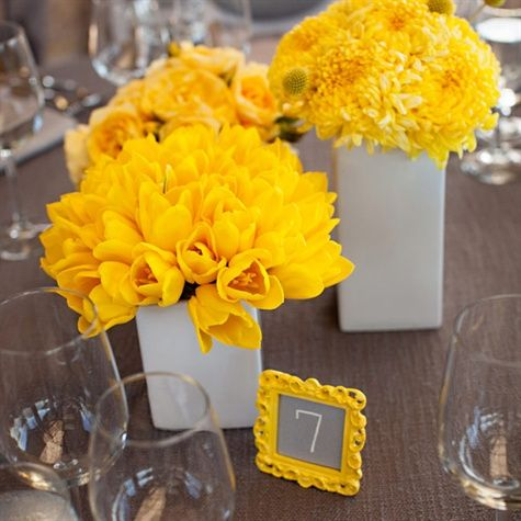 Bright Yellow Centerpieces and Table Numbers...love the contrast of this table number frame on the neutral tone/taupe linen...then the white containers with same color floral look